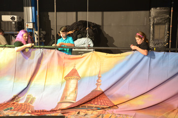 students hanging a backdrop at Largo Cultural Center Theatre Camp